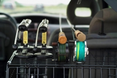 On the inside - Many cars can hold rods inside, but in most cases it's far more hazardous than having them on the outside