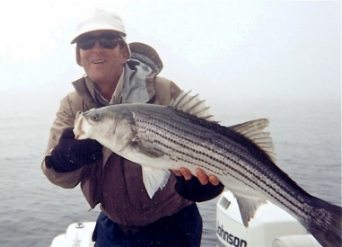 Pete with a striper - A member of his Phocus Group as he calls them.