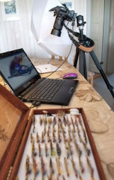 The setup - A small table top studio. My tethered D300, a flash in a small umbrella and a piece of white paper. Add to that about 75 full dressed salmon flies and there\'s the foundation for a good day not fishing...