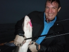 Jimmy embracing a shark -
