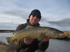 Varmá fishing sea trout in frost. Here the first fish of the trip. -