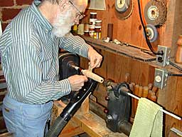 The author's lathe setup - notice the vacuum cleaner tube